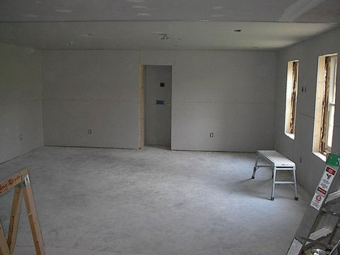 Drywall installed, windows, doors, lighting